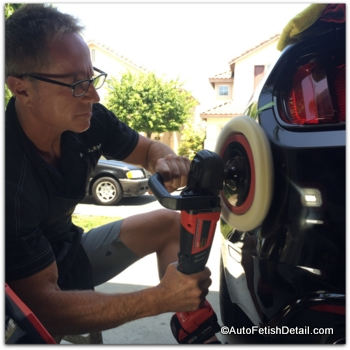 buffing a car with rotary car buffer