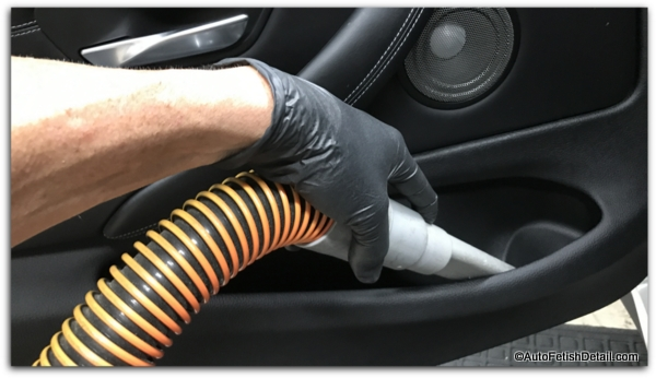cleaning vacuuming car interior