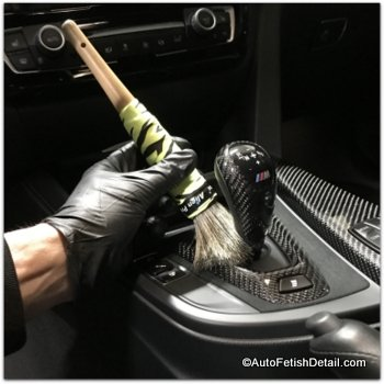 using detail brush for car interior cleaning
