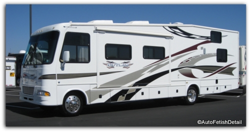 White fiberglass rv with vinyl decals